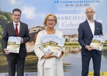Guido Wirth, Landeshauptfrau Johanna Mikl-Leitner und  Armin Laussegger präsentieren die Werbelinie zur Landesausstellung 2022.